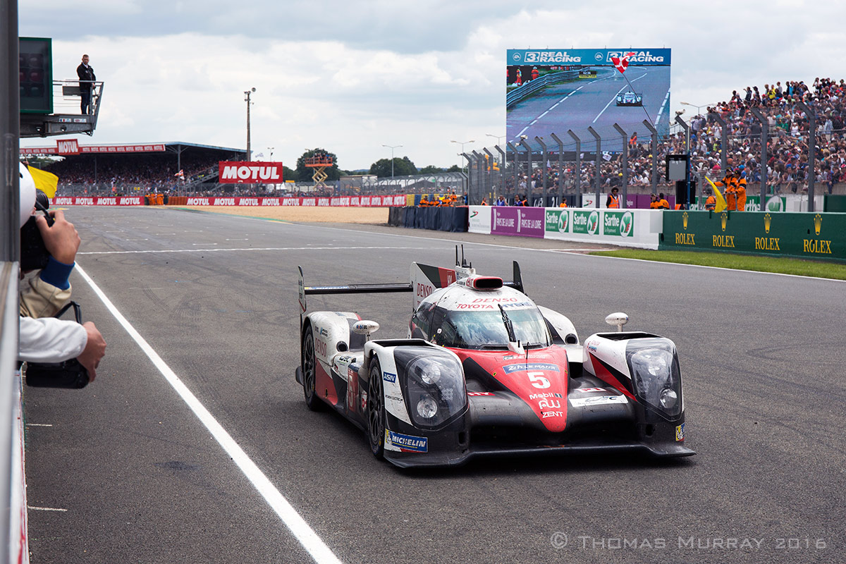 Kazuki Nakajima rolls the powerless Toyota TS050 to a halt over the start/finish line in the 2016 24 Hours of Le Mans