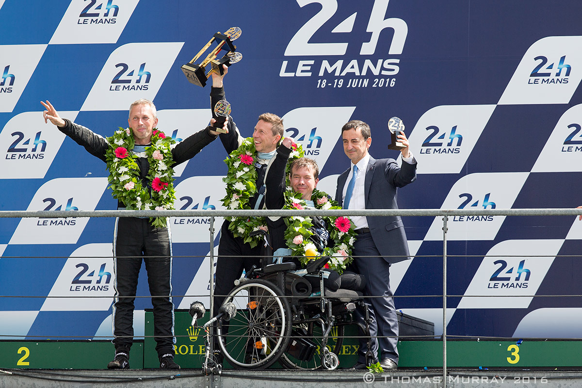 Fred Sausset and his teammates accept the Garage 56 trophy in the 24 Hours of Le Mans