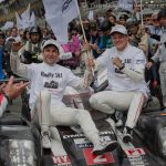 2016 24 Hours of Le Mans race winners Romain Dumas and Marc Lieb get a ride to the podium from Neel Jani